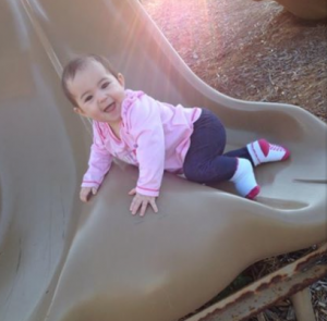Brielle playing on a slide in early 2014.