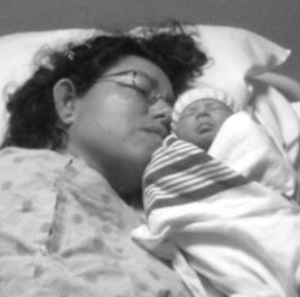 Tricia with her baby Brielle soon after giving birth in 2013.
